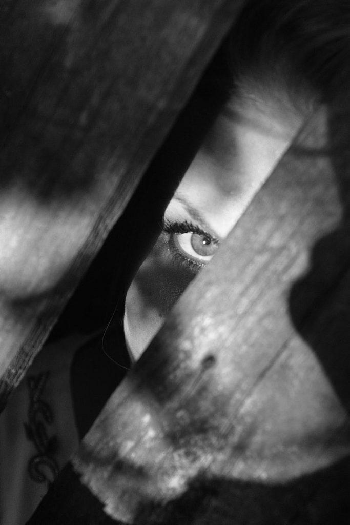 peeking through the cracks of the floorboard