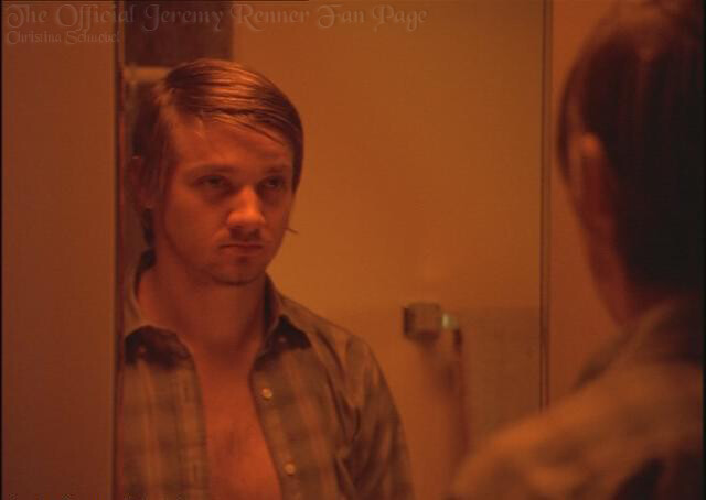 A scene from the movie 'Dahmer,' which told of Jeffrey's life. Shows an actor standing looking into a mirror.