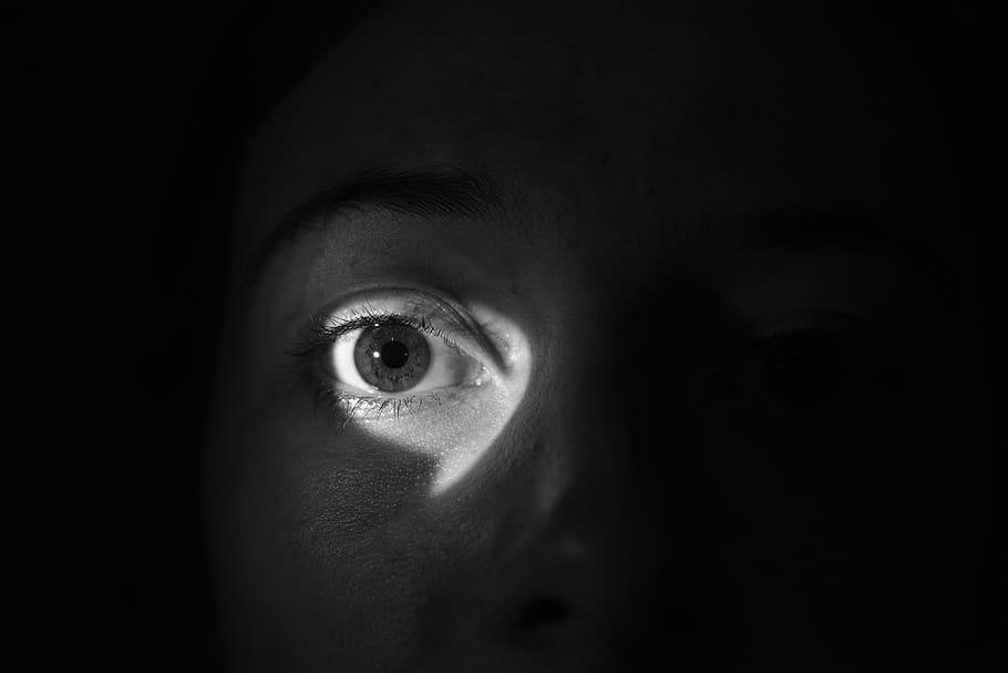 an eye peering through a hole